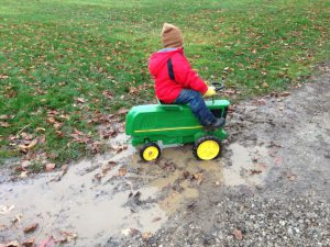 kid playing in a mud hole