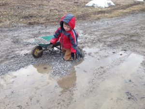 fixing a puddle in the driveway by filling with gravel