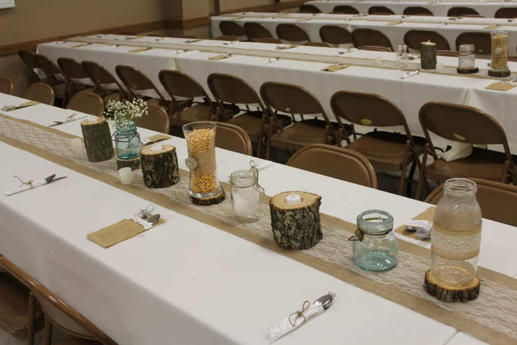 wedding centerpieces made of wood, corn and soybeans on burlap and lace