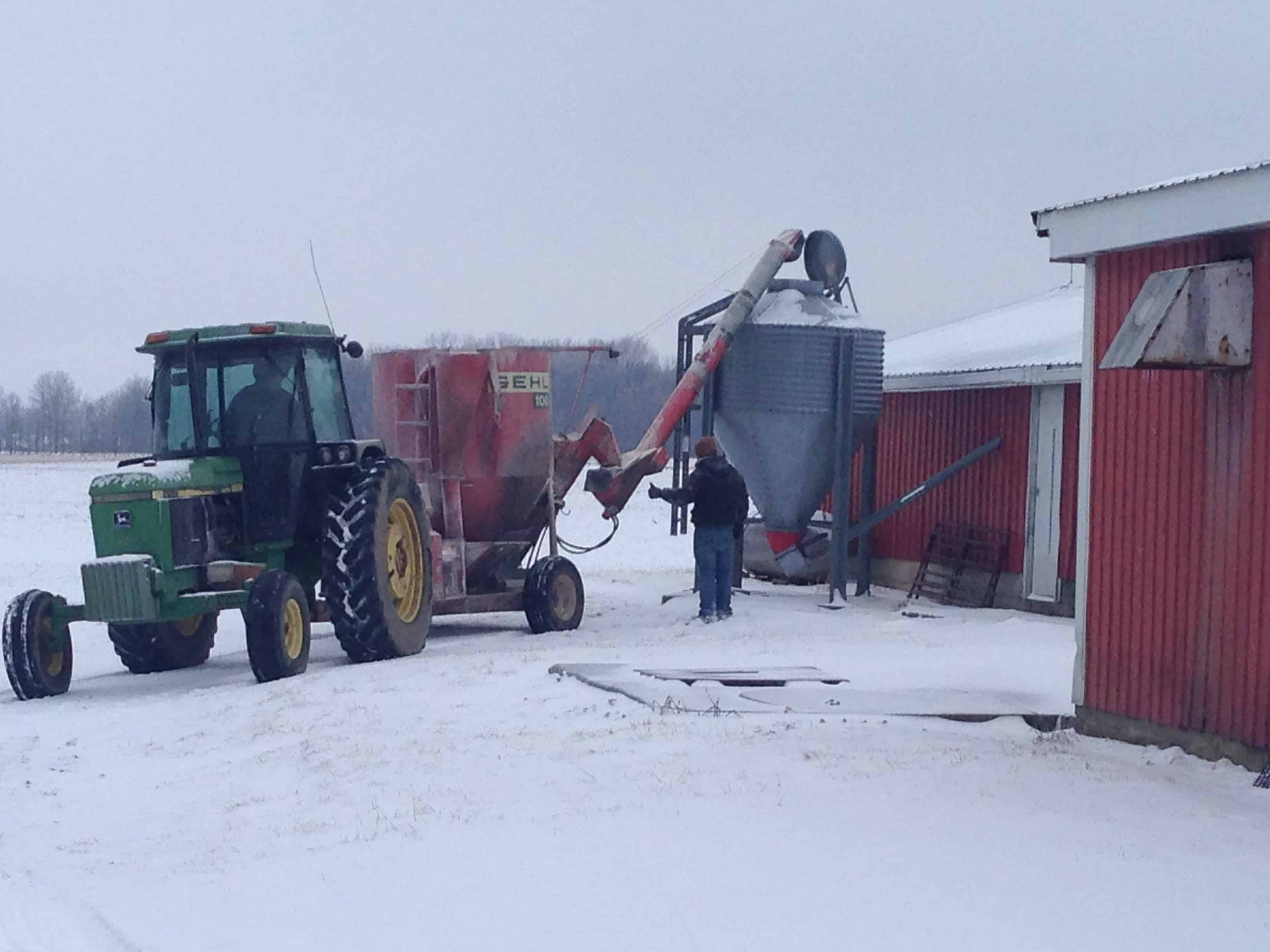 unloading feed from feed grinder