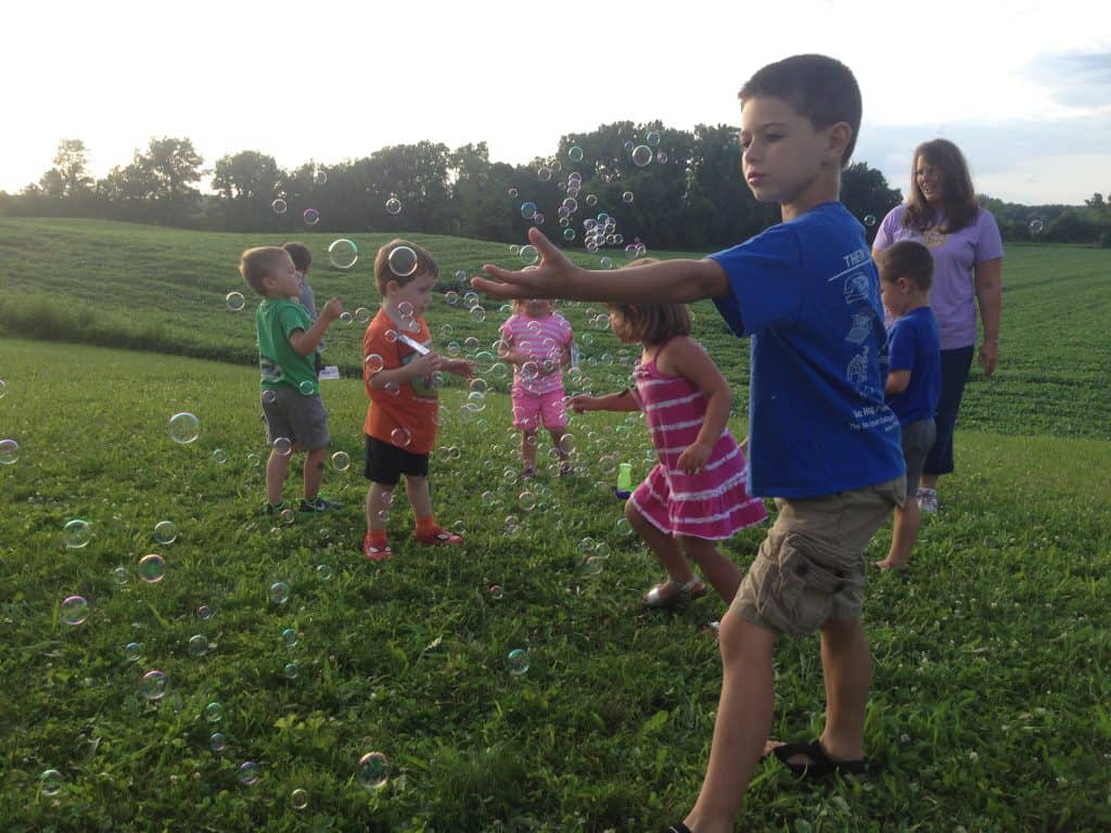 Kids playing with bubbles at Vacation Bible School
