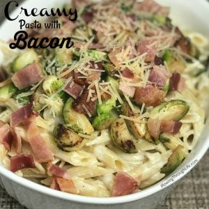 pasta with alfredo, bacon, brussel sprouts and parmesan cheese