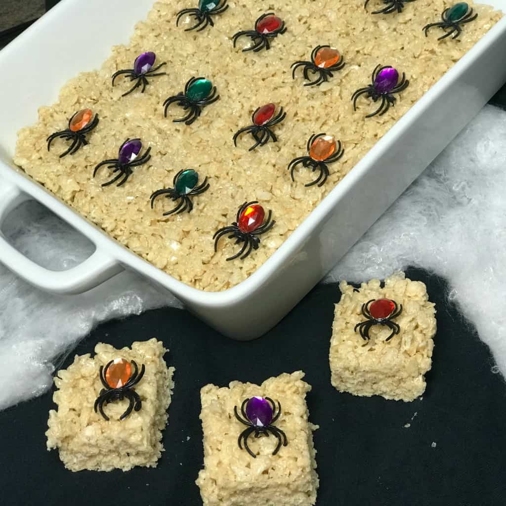 Rice crispy treats with a Halloween treat in each square makes a great Halloween party snack for kids