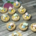 rice crispy treats made into Easter egg nests and filled with mini Cadbury eggs