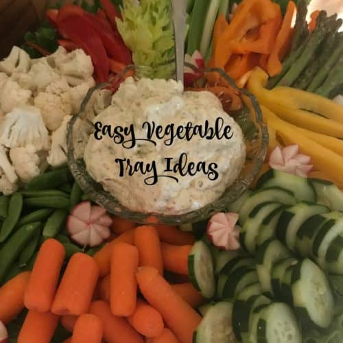 Vegetable platter with dip and garnish. Vegetables cut in interesting ways