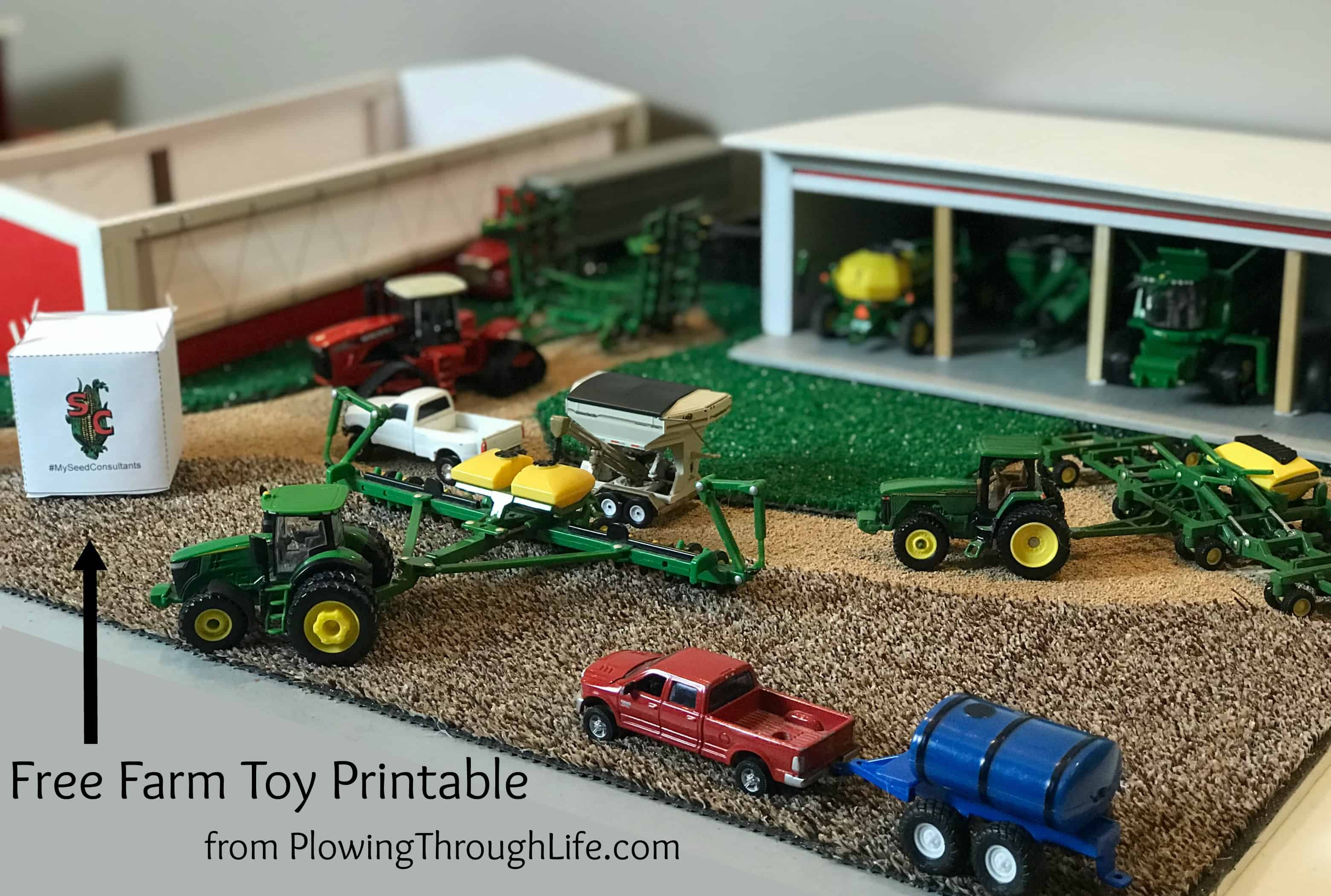 free Seed Consultants farm toy scene printable seed sack along with several John Deere 1/64th scale farm toys