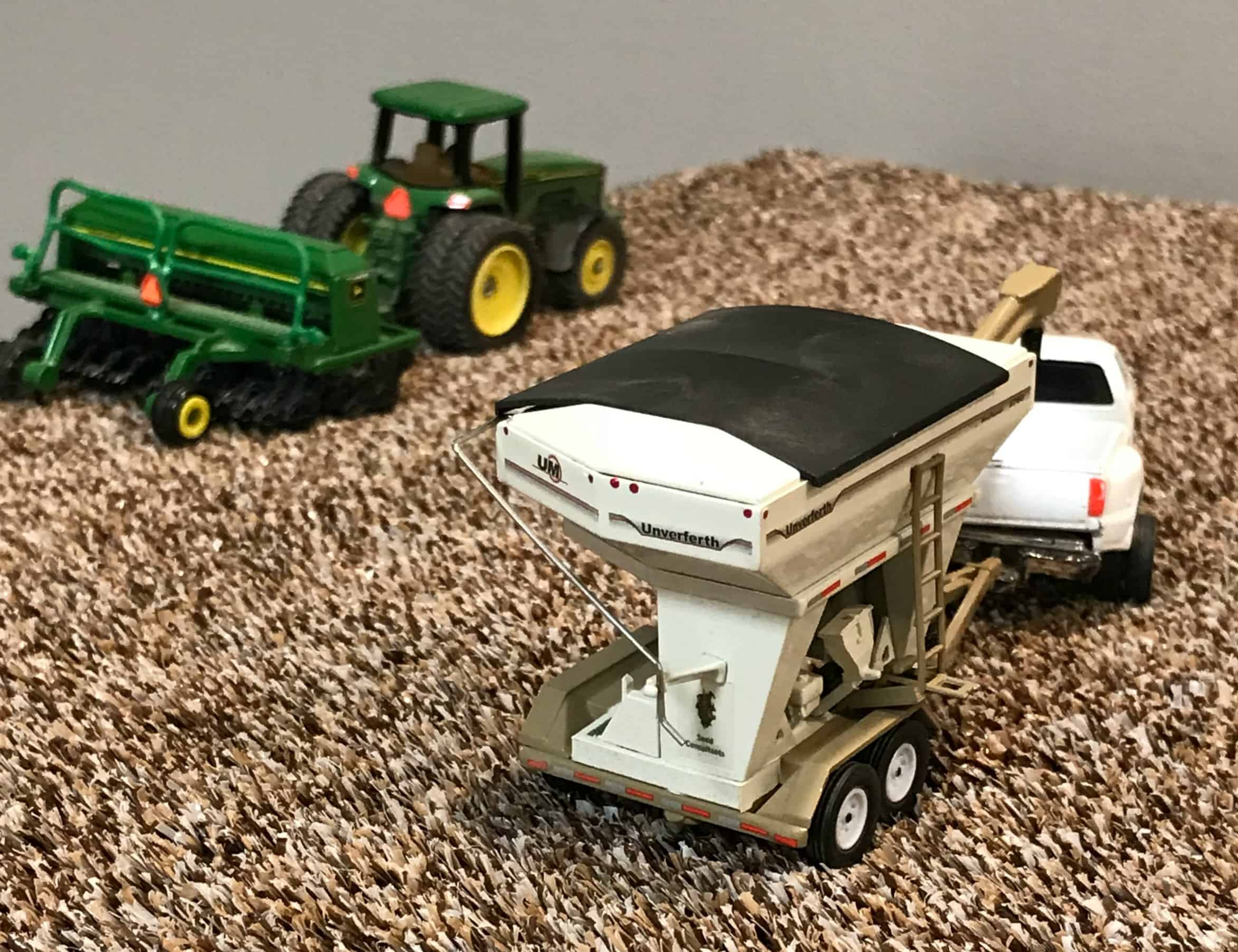 farm toy seed tender in planting scene