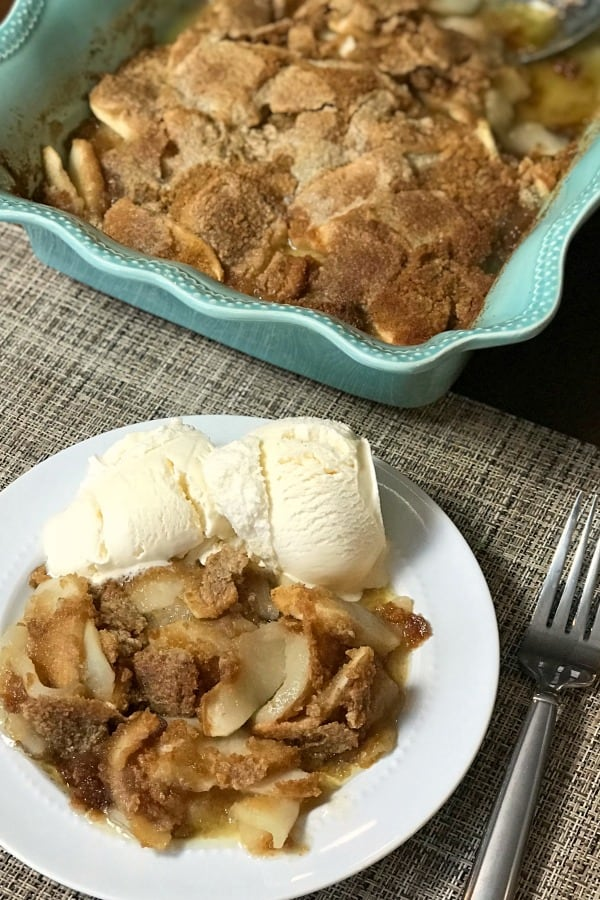 Farmhouse Apple Flip on plate with ice cream next to full baking dish