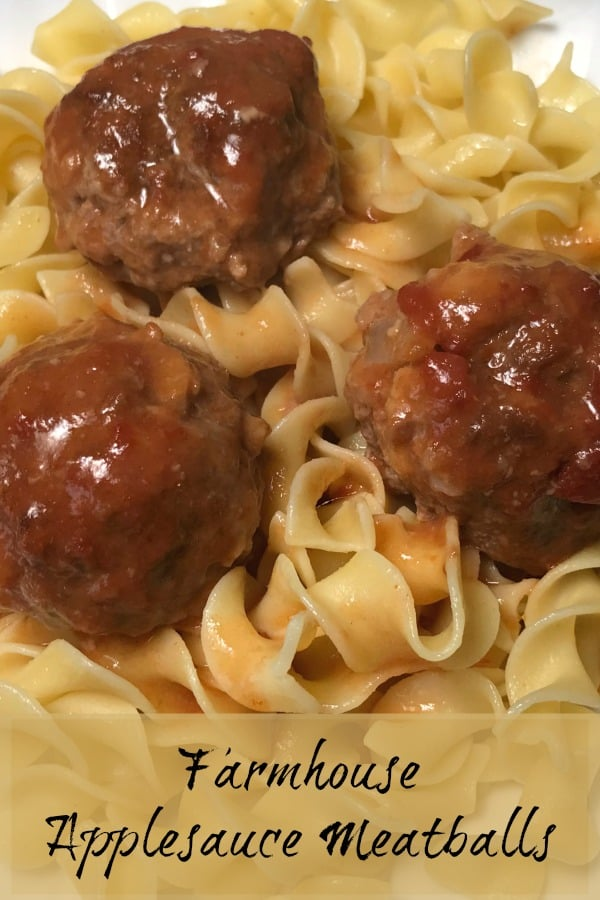 Three moist farmhouse Applesauce Meatballs over noodles