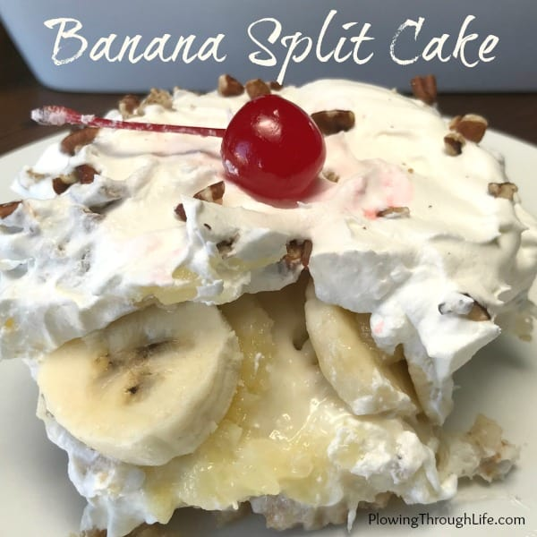 Banana Split Cake with a vanilla wafer crust, cream cheese mixture and fruit layer and topped off with cool whip, maraschino cherries and nuts