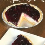 Easy cheesecake with berry pie filling on a plate by pie