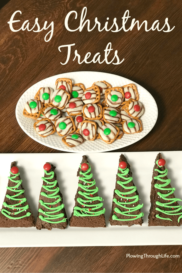 Hug and M&Ms melted on pretzels and Christmas trees made out of brownies with some green icing