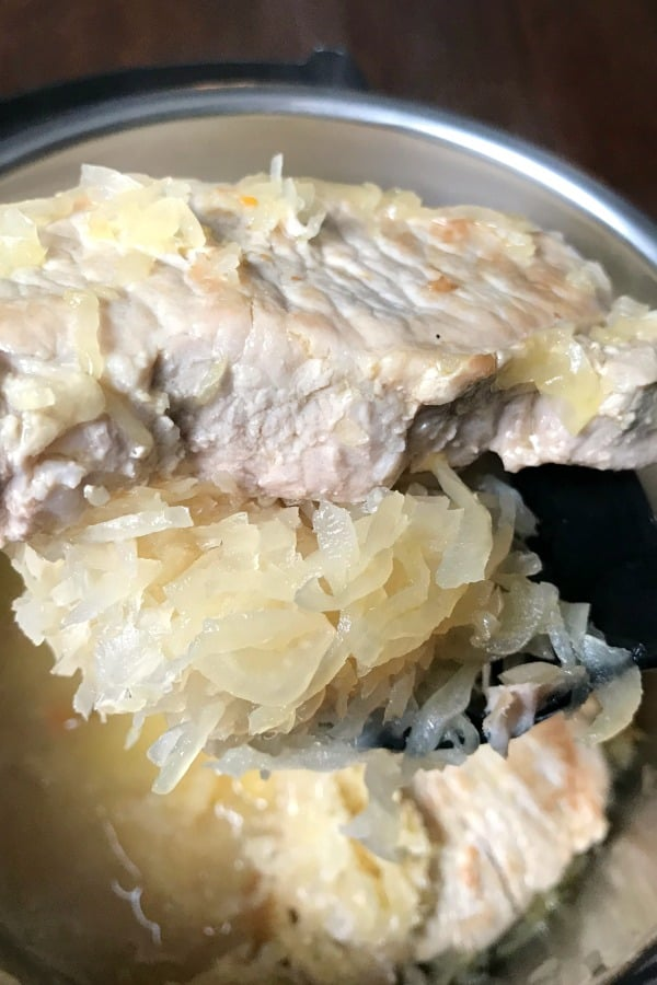 Cooked pork chops and sauerkraut in an electric pressure cooker