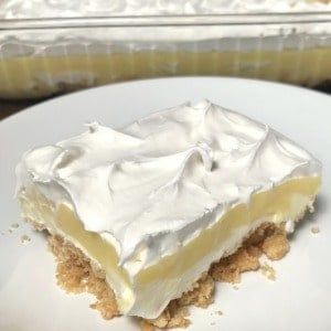 Square piece of Banana Cream Delight on a white plate