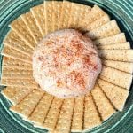 Crackers in a circle around a chili cheese ball
