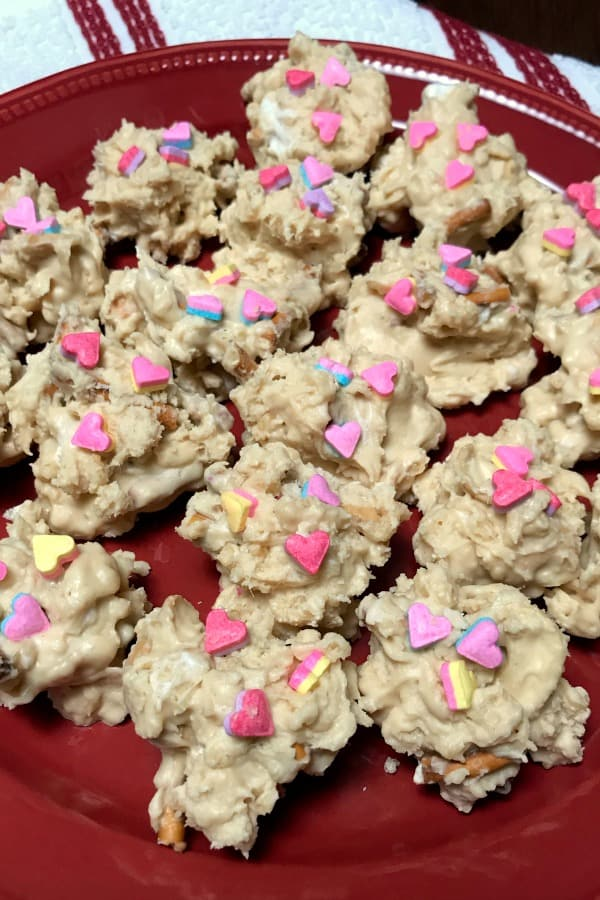 Fun and easy homemade Valentine candy these Valentine Drops with white chocolate, pretzels, crispy rice cereal, peanut butter, and cashews are delicious.