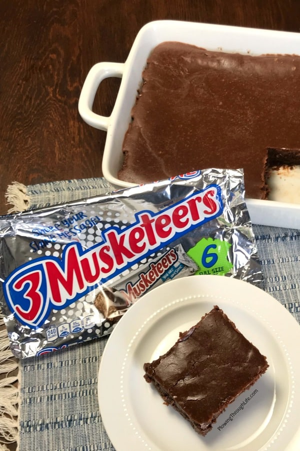 3 Musketeersbirthday cake in dish and on plate with 3 Musketeers package