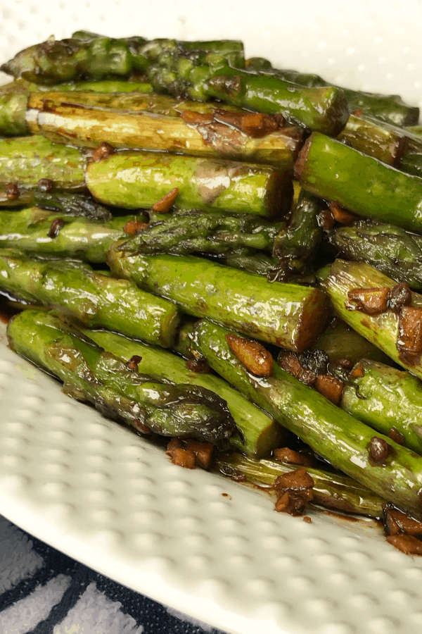Soy sauce sautéed chunks of asparagus with bits of fresh garlic and ginger creates a wonderful umami flavor of savory and salty.