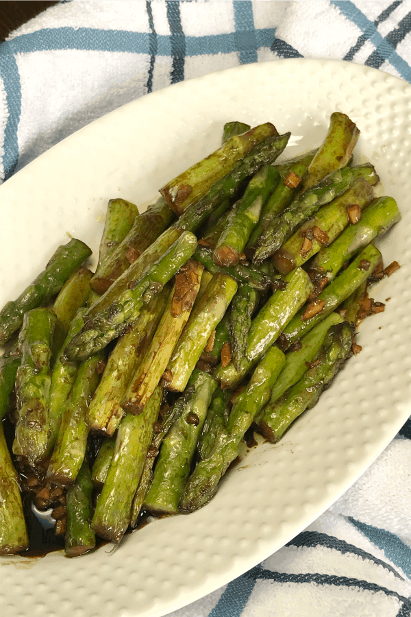 Asian Asparagus recipe is a vegetable side dish for Easter on a blue and white plaid towel