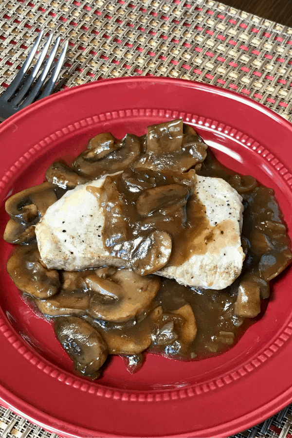 We love pork and fresh mushrooms, so we wanted to create a recipe to make pork chops in the Instant Pot with a fresh and flavorful gravy.  These Instant Pot Pork Chops with Mushroom and Onion Gravy make a great supper!