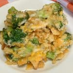 close up of Cheesy Broccoli Casserole on a small white plate