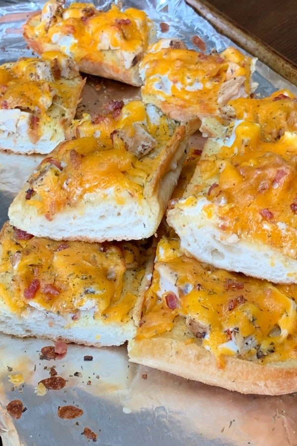 Chicken Bacon Ranch Sandwich pieces on a foil lined baking sheet.