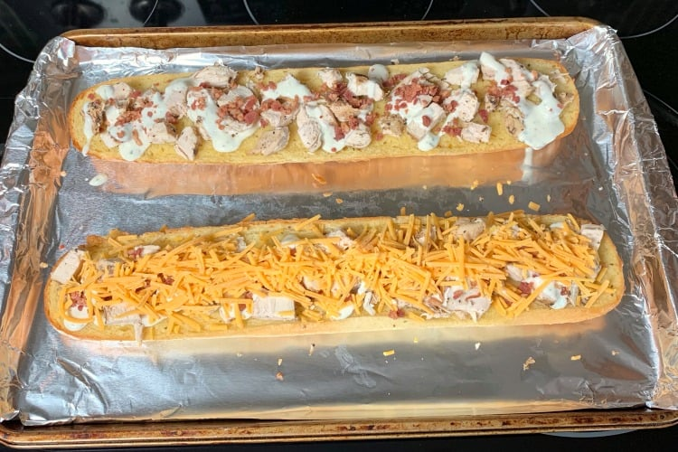 Chicken bacon ranch sub assembly on loaf of frozen garlic bread