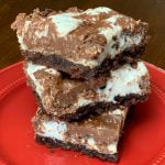 Gooey Marshmallow Brownies on a red plate