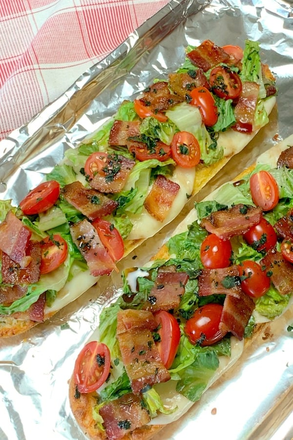 Bacon, Lettuce & Tomato without mayonnaise on foil covered baking pan