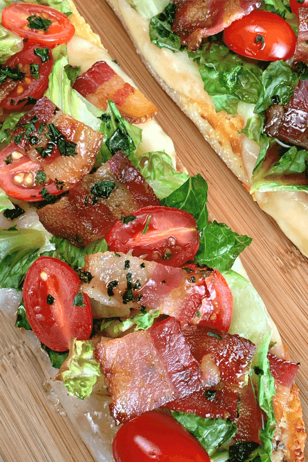 Close up Open-Faced Italian BLT with grape tomatoes, bacon, lettuce and balsamic glaze on garlic bread