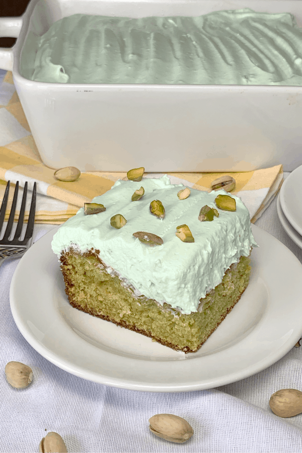 Easy Pistachio Pudding Cake is a traditional cake from a box mix with pudding mixes added for extra flavor