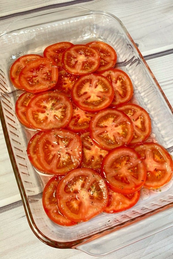 sliced tomatoes in marinade