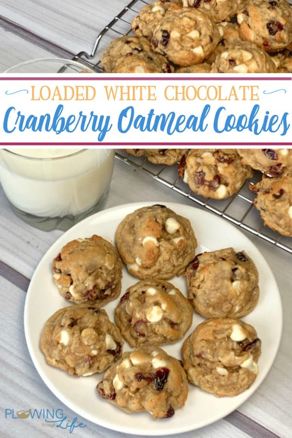 Loaded White Chocolate Cranberry Oatmeal Cookies on a plate with a glass of milk