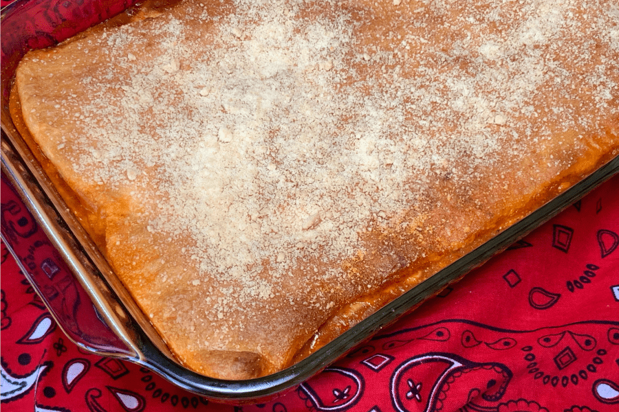 Layer of refrigerated crescent roll dough on a 9 x 13 pan of Upside-Down Pizza Casserole