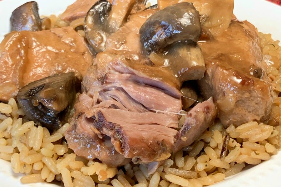 Country style pork ribs over rice with mushroom gravy and wine sauce
