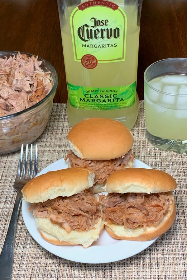Pulled pork sandwiches next to margarita mix and shredded pork