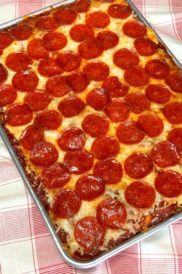 jelly roll pan of spaghetti pizza