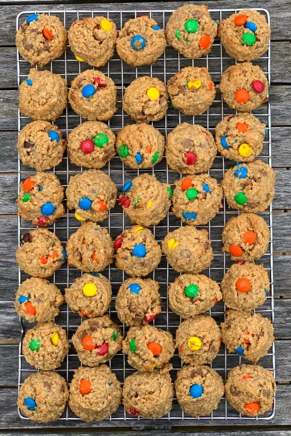 Flourless monster cookies with M&Ms on a baking rack