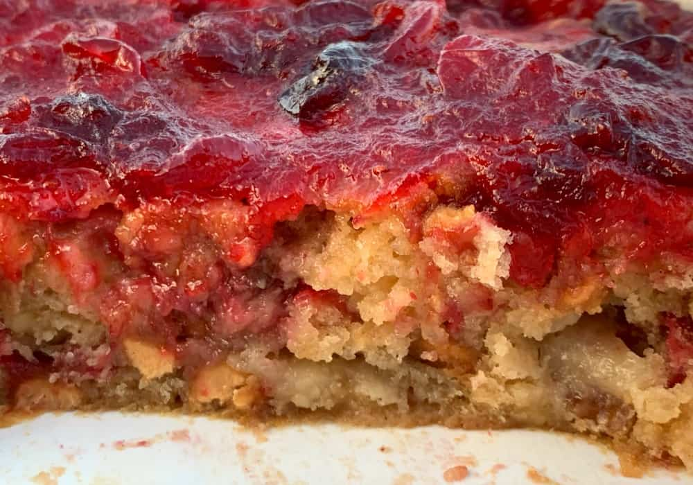 Slice of Cranberry Apple Spice Bar in 9 inch square baking pan