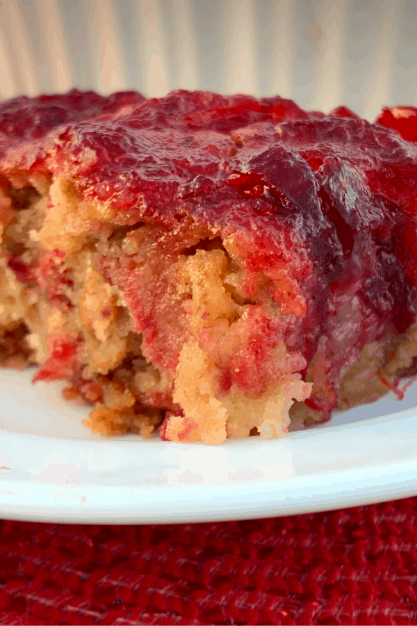 Piece of cranberry dessert bar on white plate