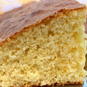Close up piece of cornbread with crust