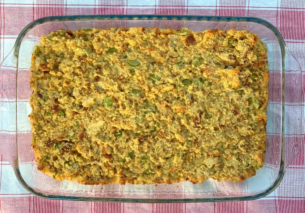 9 x 13 pan of cornbread stuffing on a red plaid napkin