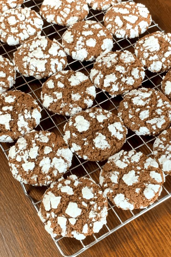 chocolate pixie cookies on rack on wood table