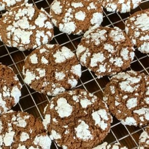 Chocolate pixie cookies on cooling rack
