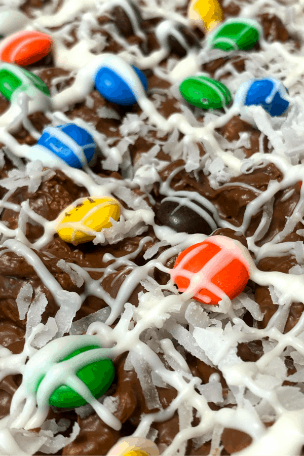 close up chocolate pizza with M&Ms, coconut and white chocolate drizzle