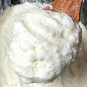 creamy mashed potatoes on a wooden spoon