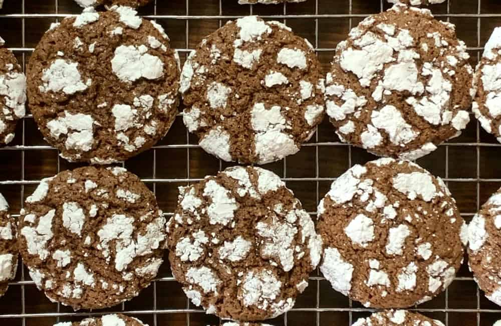 chocolate cookies covered in powdered sugar