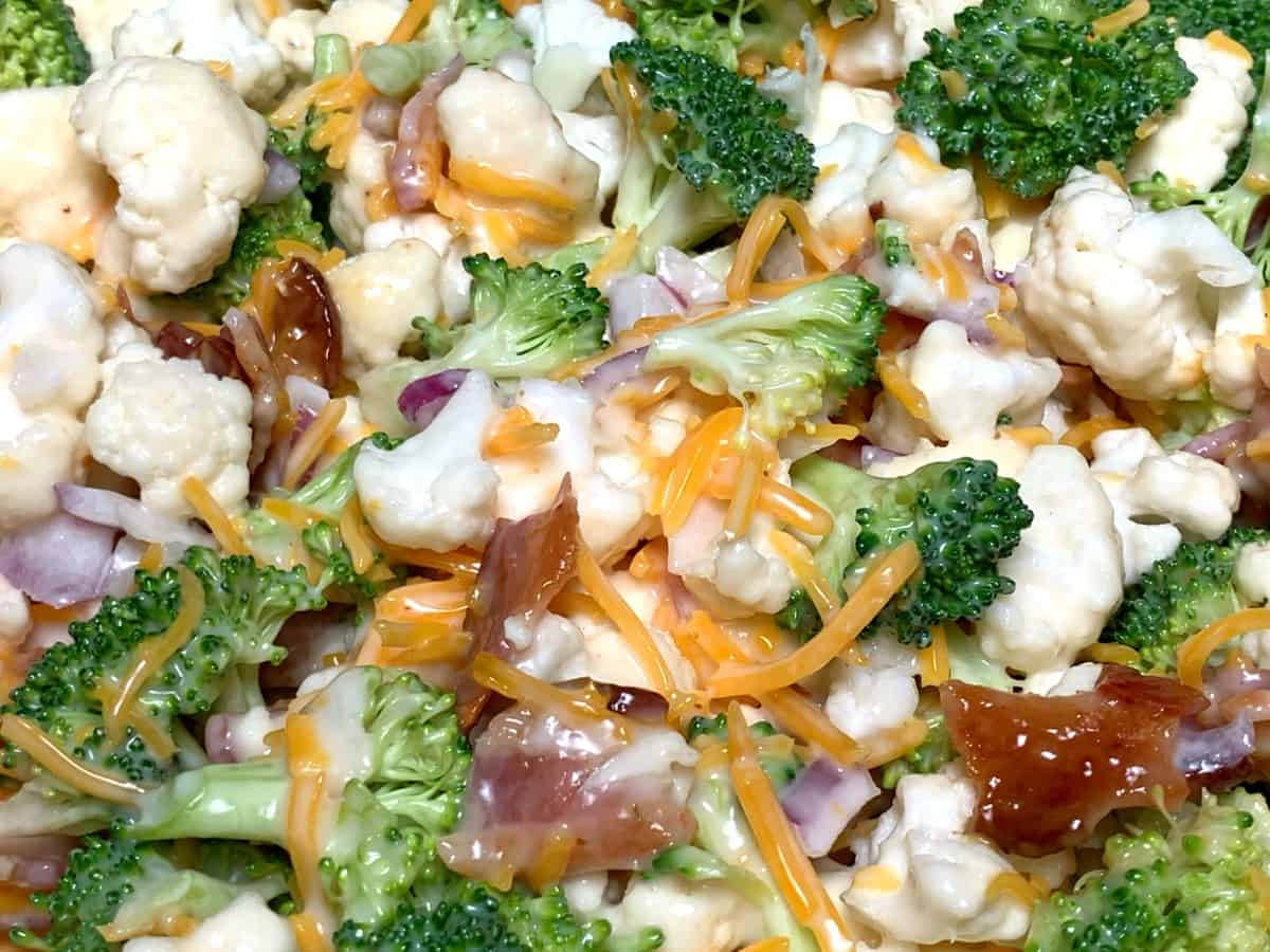 Crunchy, raw broccoli and cauliflower bites with bacon, cheese, onion and a light, sweet dressing made with Miracle Whip