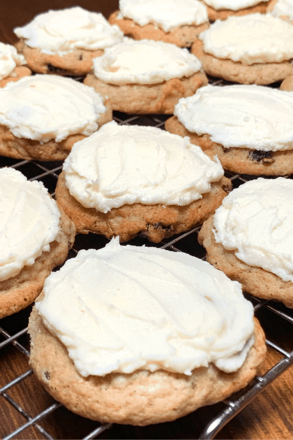 white hermit cookies with icing on cooling rack