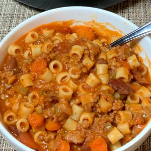 bowl of Italian sausage and pasta soup with ditalini and vegetables